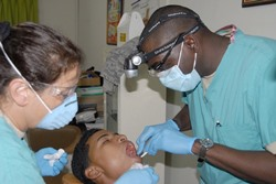 Woodsboro TX dental assistant with dentist and patient